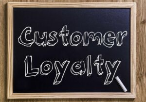 Customer loyalty written on a blackboard