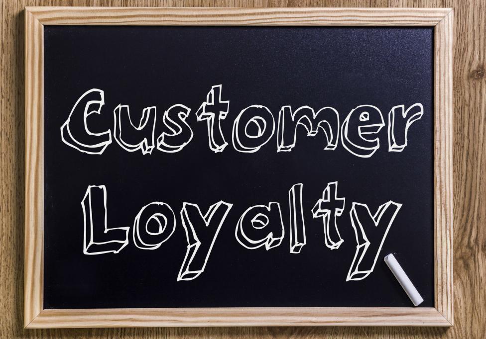 Customer loyalty written on a blackboard