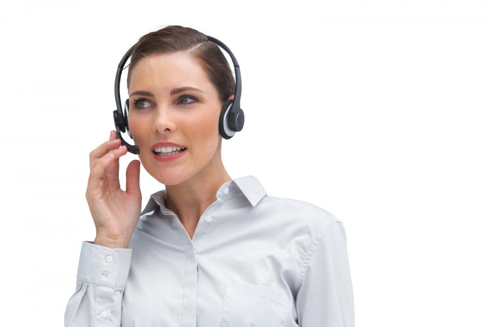 Agent wearing headset to receive phone call